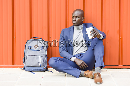 fashionable businessman sitting in front of