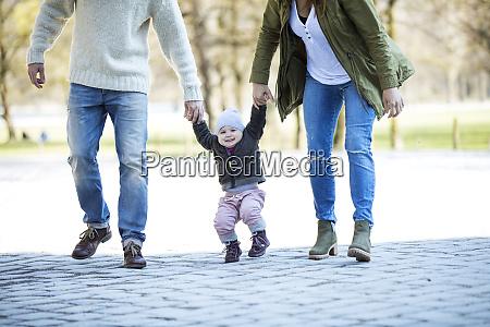 portrait of happy girl walking hand