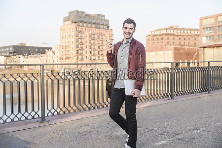 happy young man with tablet cell