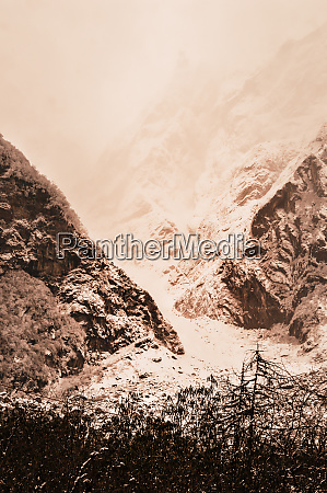 snow capped mountain peaks frozen landscape