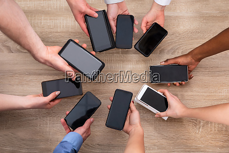 group of people showing cellphone against
