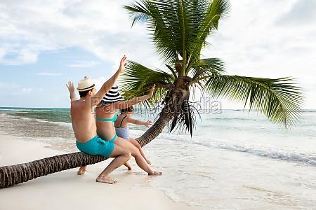 happy family enjoying on the beach
