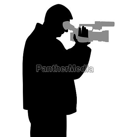 mann mit videokamera schaut durch sucher