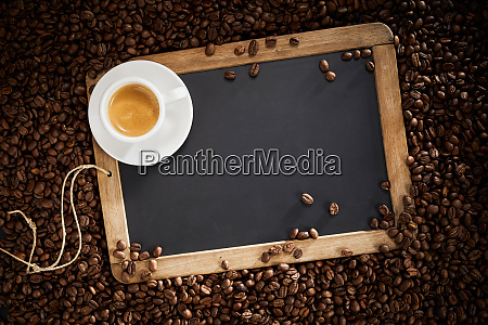 blank school slate with cup of