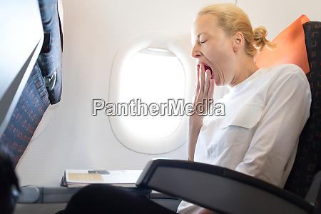 beautiful casual caucasian woman yawning on