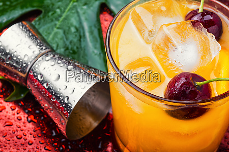 orange drink with cherry