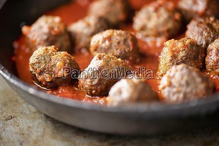 rustic italian meatballs in tomato sauce