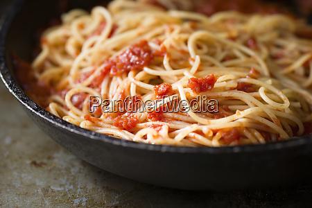 rustic italian spaghetti pasta in tomato