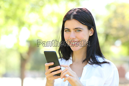 happy adult woman holding phone looking