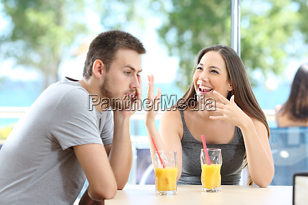 bored man listening her friend talking