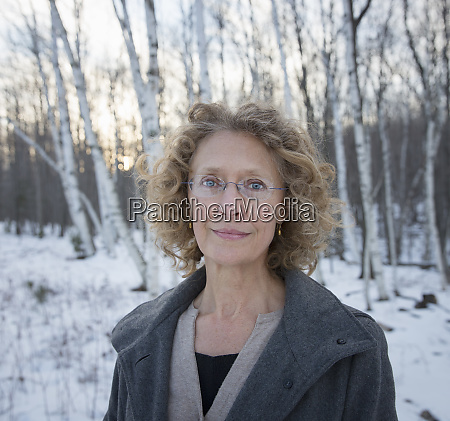a mature woman with curly read