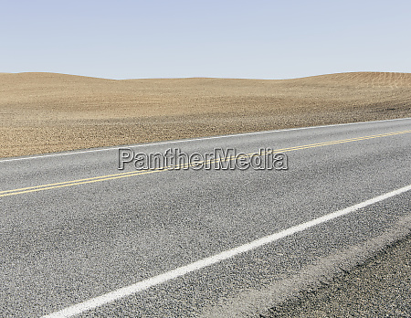 road through ploughed farmland near pullman