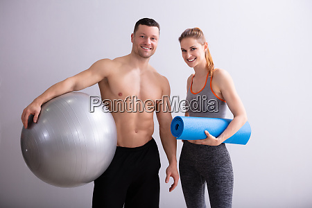 male and female sports person holding
