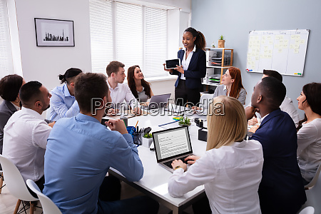 smiling young businesswoman giving presentation in