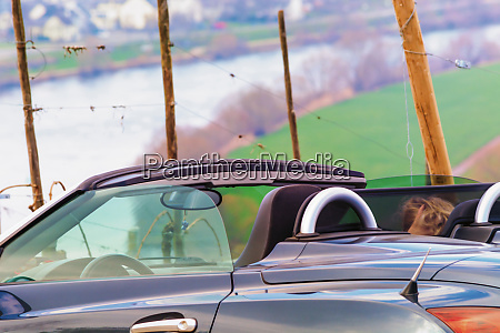 convertible car driving on the mosel
