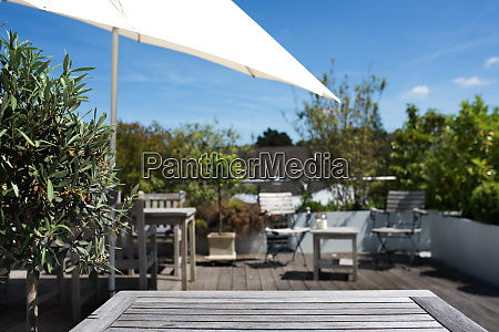 sun terrace with empty wooden table