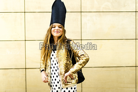 portrait of smiling girl wearing golden