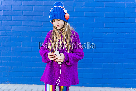 girl wearing blue cap and oversized