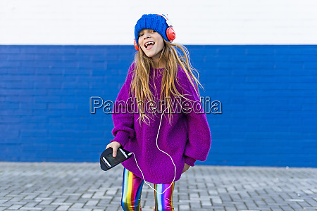 portrait of happy girl singing while