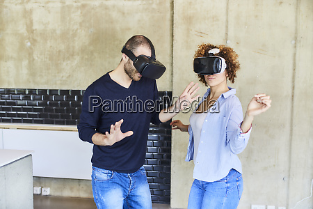 man and woman wearing vr glasses