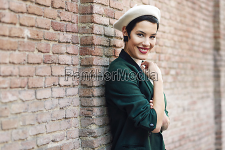 portrait of smiling fashionable young woman