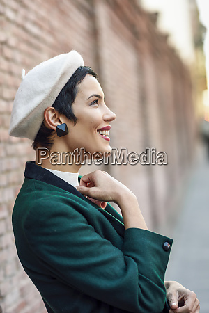 happy fashionable young woman wearing a