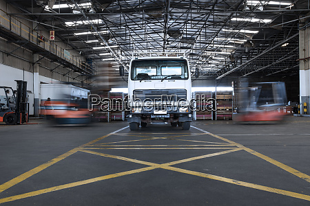 parked truck in warehouse and moving