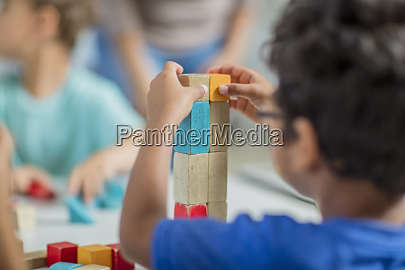 children playing with building blocks in