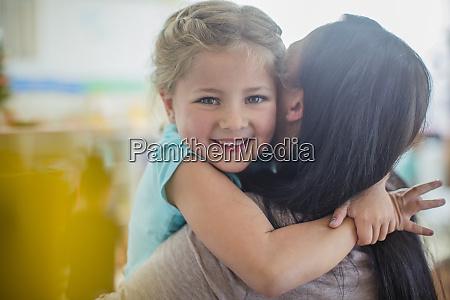 portrait of smiling girl in kindergarten