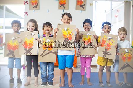 portrait of smiling children presenting images