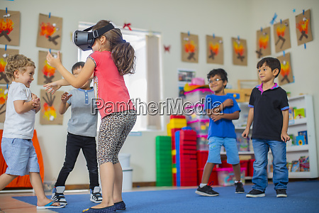 children with vr glasses playing in