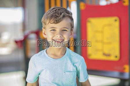 portrait of happy boy on playground