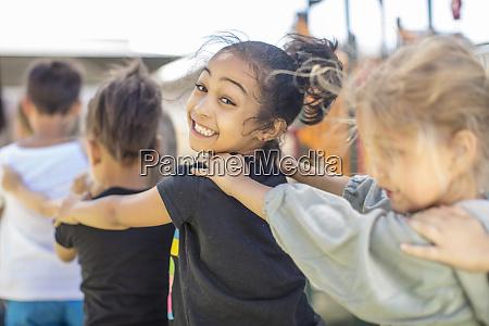 happy children making a conga line