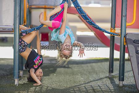 happy girls playing on playground of