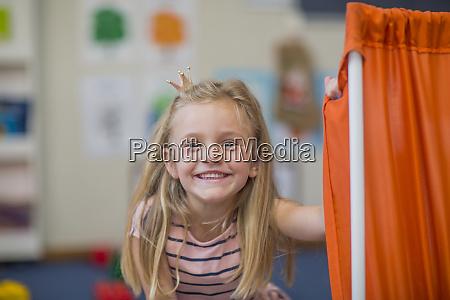 portrait of happy girl wearing miniature