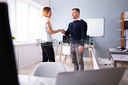 happy businessman shaking hands with his