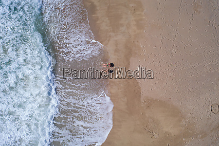 aerial top view of couple laying