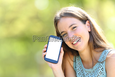 happy woman showing a blank phone