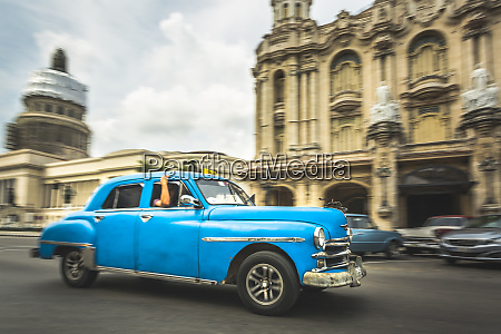 turquoise american classic car taxi outside