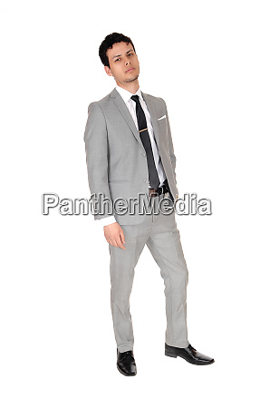 young business man standing relaxed in