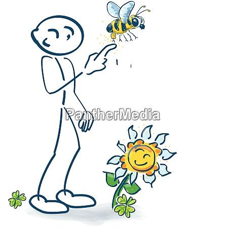 stick figur mit einer kleinen bee
