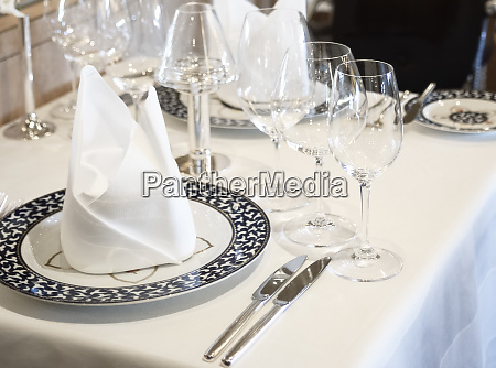 restaurant table set up with wine