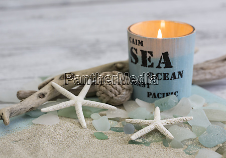 maritime beach still life with candlelight