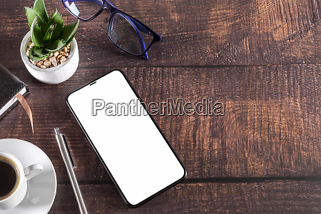 working table with smart phone notepad