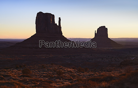 buttes at sunset in monument valley