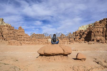 woman sitting on rock in goblin