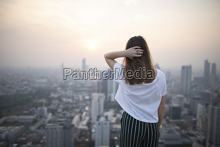 young woman and cityscape of bangkok