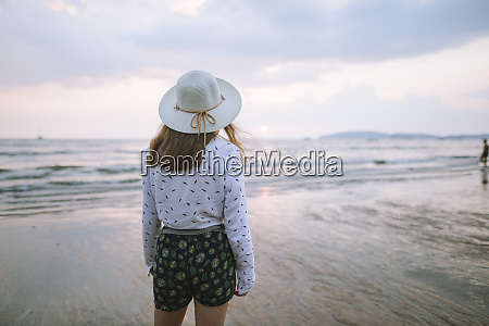 young woman in sun hat on