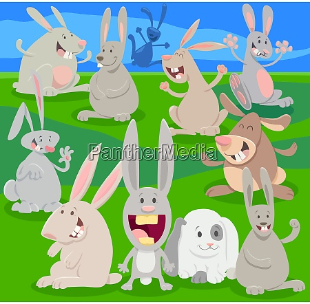 happy rabbits on meadow cartoon illustration