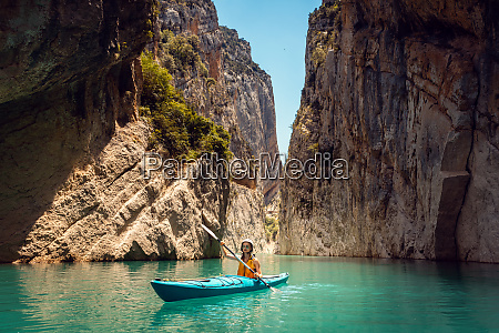 woman on a kayak in the